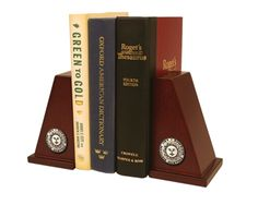 Our hardwood bookend set features medallions of your school seal in a Masterpiece, Spirit or Engraved medallion. Includes a metal base to support large books. Search for your school or organization today!