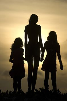 this is a great picture idea for a family/mother daughter/sister photo. It is a great example of the technique silhouette.