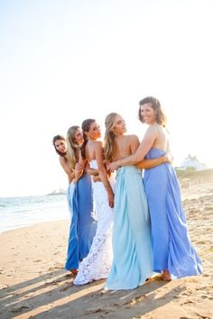 The dresses get lighter until they turn white when the bride walks down the aisle. I LOVE THIS IDEA!