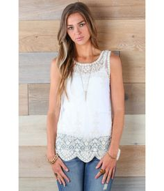Romantic Lace Tank. Ivory lace sleeveless top with delicate flower detail around trim and scalloped bottom. Buy it now at bohme.com
