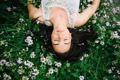 Pose laying down in the grass