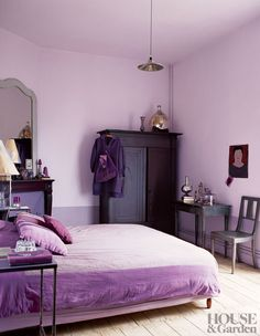 The lavender bedroom in a French country house is punctuated by silvery mercury vases and candlesticks. #HouseandGarden