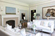 Light Living Room with white facing sofas and equine print - St. Nicholas Home by Nightingale Design