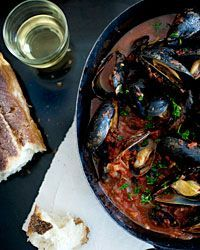 Steamed Mussels with Tomato-and-Garlic Broth via Food & Wine