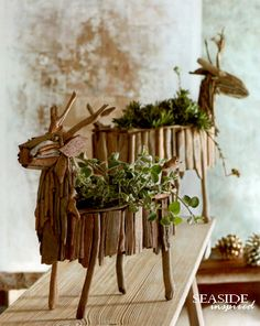 Driftwood Reindeer Planter. Charming reindeer stand at the ready to hold foliage. Planters are fashioned from natural pieces of found driftwood so no two are alike. Fill with potted plants, holiday sprigs or lights and ornaments.