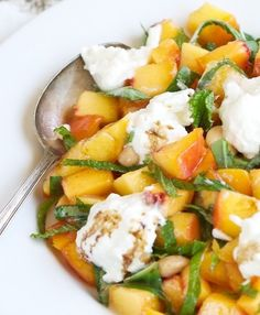 Nothing says fresh-picked flavour like @Four Seasons Hotel Los Angeles at Beverly Hills' Peach Salad with Burrata and Sicilian Almonds. Click through for the recipe.