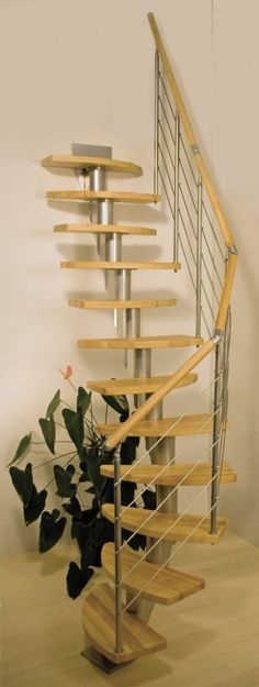 Dolle Copenhagen Space Saving Stair Kit (Loft Stair) -- The design of the steel supports for the Copenhagen enables the tread rise and angle to be adjusted. With solid Indian rubber tree (hardwood) treads, a matching handrail and a wire/rods banister with steel uprights, the Copenhagen makes for a elegant stair kit. The standard unit is complete with 12 treads, suits a floor to floor height up to 2920mm and allows for 90 degree turns to allow for multiple configurations. # £820.00 + VAT
