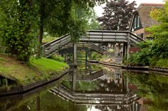 """Giethoorn - Netherlands This idyllic Dutch village, once known as the """"Venice of the North,"""" has little canals instead of roads, making the land around each house its own little private island."""