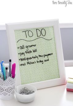 Dry Erase Board :   Take a picture frame and insert decorative paper.  Use a dry erase maker to make notes!  I have mine on the kitchen counter