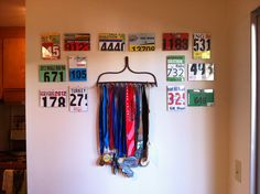 Race bibs and medals display- LOVE the idea of using an old rake to display medals!!! Too cool!! race bib
