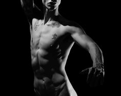 Of muscle standing still  movement seemed to trill  an exciting eye   that moved   in and out of the grooves    with arms held out   for more   wanting just to explore  shadows hitting dim light   creative model of the night