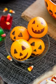 Here's a fun way to liven up a Halloween party table or school lunch, draw funny jack-o-lantern faces on clementines and oranges.
