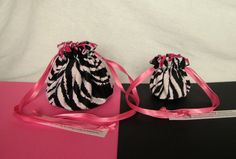 """Individual compartments inside these bags will separate and protect your jewelry.  The larger bag is perfect to take on a trip, the cute, mini size is perfect to put in your purse or gym bag.  What an excellent gift!  We carry 5 sizes of bags in over 250 colors.  Each set $14.25 """"Pink Zebra set"""" shown @IslandJewelryBags.com #Jewelry Bags"""