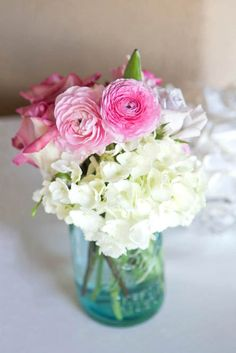 more pink and white flowers in ball jar