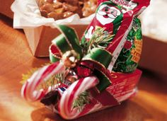 Santa's Candy Sleighs...glue gun, box raisins, candycanes, russell stover peanut butter santa, cadbury cream tree