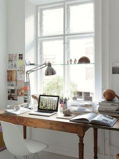 Big window + big wooden desk + white surroundings