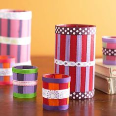 Artistic Illumination Turn simple glass votive holders into mini works of art with alternating strips of ribbon. Attach the ribbons with decoupage medium, layering ribbons as desired.