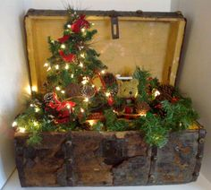 Antique Christmas Trunk with Christmas tree and lights, vintage trunk, Christmas decoration.