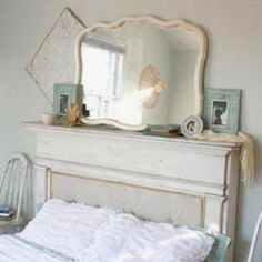 Use old fireplace mantle for headboard.