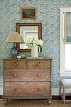 Phoebe Howard. Note the subtle blue painted flourish on the rustic chest that ties it in with everything.