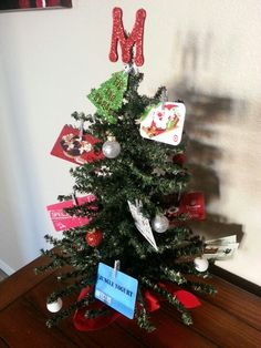 Christmas gift card tree for kids teacher. Each family contributed a gift card. Perfect gift!