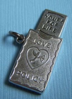 Vintage movable Wells Love Policy cupid Yours for Life sterling charm