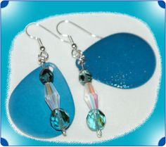 http://diginanchors.com/EarringsAlure_BlueWater - Handmade from quality lures with bright blue colors that are hotter than ever. Having the fleck finish allows it to sparkle when hit by light. Sparkling aquamarine beads and crystals are added to enhance the beauty of the earrings and the wearer.The dangling earrings are 2 inches long by 3/4 inches wide. The earwires are made of surgical stainless steel and are gold plated.