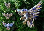 Peregrine Falcon sculpture made by Sean Avery from broken CDs. Photo via deviantart.com.
