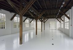 New white interior with old wooden structure. Conversion of a barack of the old penal colony Veenhuizen by Atelier Kempe Thill.