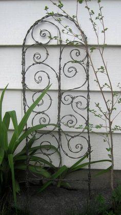 Beautiful Spirals Barbed Wire Trellis Garden Art. $57.00, via Etsy.