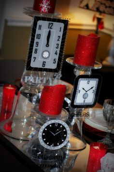 Clock centerpiece - great for New Years Eve wedding; table numbers could be the time! Love this idea in blue or silver, not red.