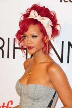 Rihanna's pin-up hair. Do the usual overnight twist-up bun to create a head of curls, undo the next morning, tie up in a ponytail and pin into a messy and undone bun. Then use a curling iron to do the front pieces.