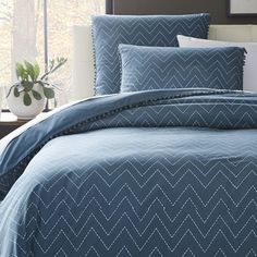 This 100% cotton Ainslie Duvet is part of our collaboration with the Brooklyn-based Jay Street Block Print Company. Embellished with pom poms, the zigzag design is hand-blocked by Craftmark-certified artisans.