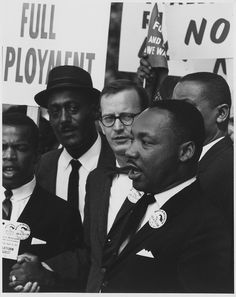 Civil Rights March on Washington, D.C, 1963    Dr. Martin Luther King, Jr., President of the Southern Christian Leadership Conference, and Mathew Ahmann, Executive Director of the National Catholic Conference for Interrracial Justice, in a crowd.