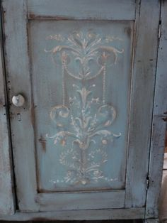Molly Susan Strong: Rustic Cabinet Redo. LOVE the hand painting on this cabinet door!