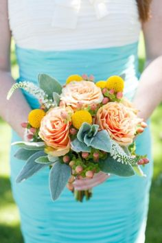 turquoise, peach, and yellow are great colors for this beach wedding bouquet