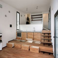 | Tre Livelli |  Liking these underfloor storage..... A 377 square feet studio home in Turin, Italy. Photos by Beppe Giardino. Designed by Studioata. ~ click on photo for more ~