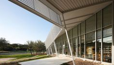The Outdoor Library: The Parman Branch is located in a rapidly growing and previously underserved section of San Antonio. The 10-acre site includes a walking trail, outdoor amphitheater, and a Rotary-funded playground. The building features optimized solar orientation and shading screens to minimize heat gain, high-performance glazing and translucent panels that maximize the use of natural light, and water-conserving fixtures. http://www.marmonmok.com
