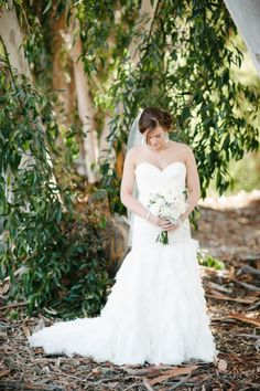 Strapless wedding gown with tiered ruffles. #bride #weddingdress #weddingchicks Captured By: Acres of Hope Photography ---> http://www.weddingchicks.com/2014/05/06/pot-your-own-succulent-centerpieces/