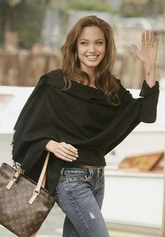 Not a huge Angelina fan but her outfit here rocks. LOVE that shawl-like top.