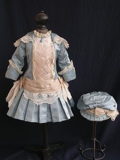 Examples of antique dolls' dresses
