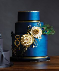 ROYAL BLUE Banana chocolate cake layered with salted caramel buttercream, covered in fondant and hand painted royal blue. The Wedding Cake Shoppe, theweddingcakeshoppe.com