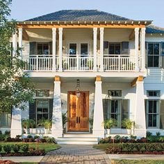 Bayou Bend | This quaint coastal cottage with double galleries is rooted in the architectural traditions of the Deep South, but its open floor plan and vibrant interiors are fit for the modern family. | SouthernLiving.com