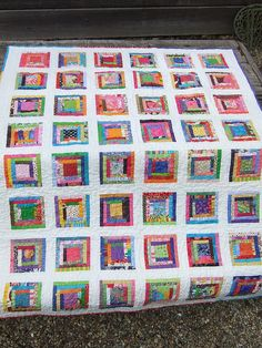 scrap quilt based on log cabin Like the play off of white background. look closer
