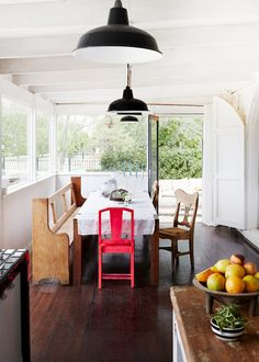 A renovated church becomes a family home // casual dining, bench, pink chair