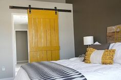 105 DIY Projects That Will Make You Proud: Instead of wallpaper, customize your own wall art with a Decoupage Ceiling.  : Even if you weren't the best math student, this Dimensional Geometric Wall Art tutorial is easy!  : This sliding barn door  in bright yellow, created by House*Tweaking is so brilliant! I might have to try it at my home, too.