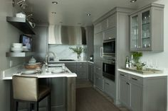 This is a super cute little kitchen, love the cabinet color too