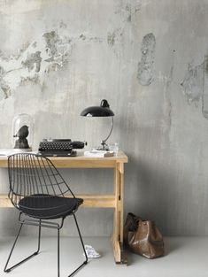 Simple desk with rustic wall