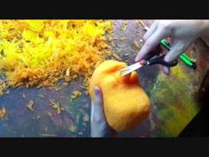 Speed carving a foam puppet head with scissors