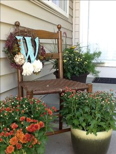 Fall front porch decorating -- I love the wreath on the chair instead of on a door